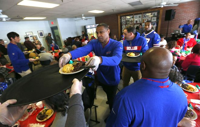 Bills defensive coordinator Leslie Frazier and 14 other Bills coaches serve a Valentine's meal at the Buffalo City Mission on Wednesday, Feb. 13, 2019. (Mark Mulville/Buffalo News)