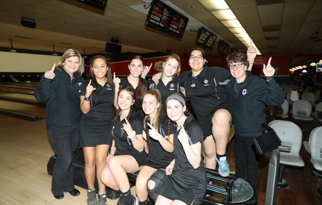 The Division I champion Orchard Park girls bowlers, shown after winning last year's sectionals, are looking to repeat. (James P. McCoy/Buffalo News)