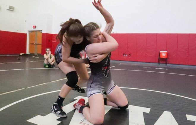 Bailey Crouse of Tonawanda, left, wrestles Kendra Cheers of Niagara Wheatfield during practice at Niagara Wheatfield High School on Tuesday, Feb. 12, 2019. (James P. McCoy/Buffalo News)