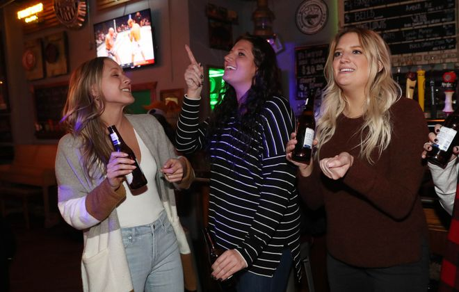 Singing along to Sterling's karaoke are Samantha Tomczak, Anne Marie Reedy and her sister Grace Reedy. (Sharon Cantillon/Buffalo News)