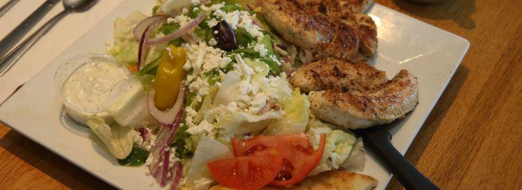 An open chicken souvlaki is a specialty at the Athens restaurant. (John Hickey/Buffalo News)