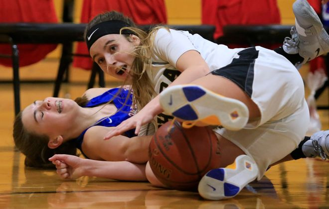 Cardinal O'Hara player Mia McCarthy dives for a loose ball against Williamsville South. (Harry Scull Jr./Buffalo News)