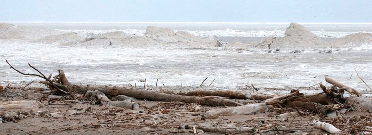 If global warming keeps soil from freezing, shoreline such as that found at the Town of Hamburg beach would be more vulnerable to erosion by wave. (Robert Kirkham/News file photo)
