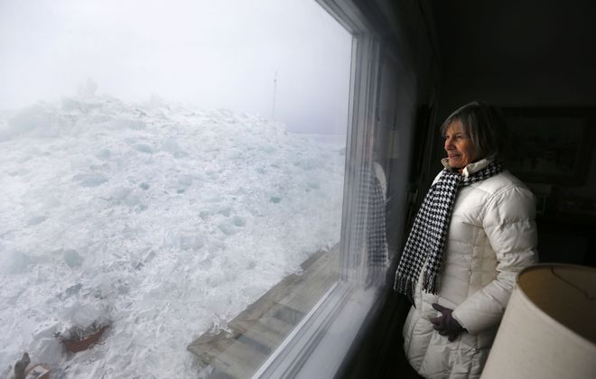 Fay Davis looks out to the ice mound that covered her pation at her home on Hoover Beach in Hamburg Monday, February 25, 2019.      (Mark Mulville/Buffalo News)