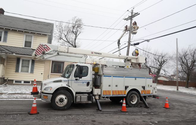 National Grid employees work to restore power in the Town of Tonawanda at Englewood Avenue and Tillotson Place. (John Hickey/Buffalo News)