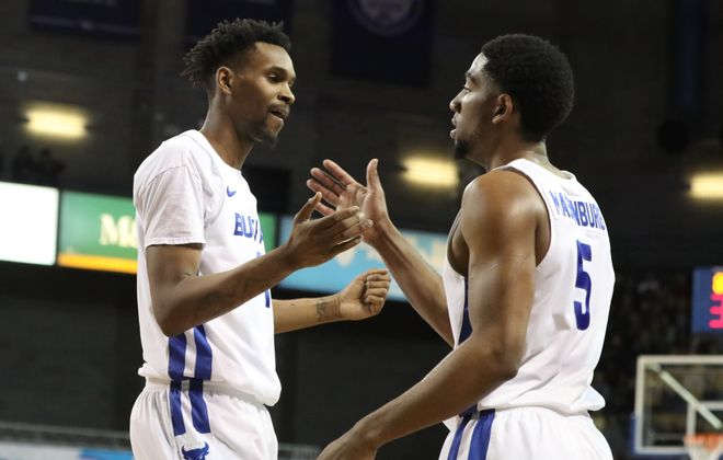 Montell McRae and CJ Massinburg hit the road to face Miami Friday. (James P. McCoy/Buffalo News)