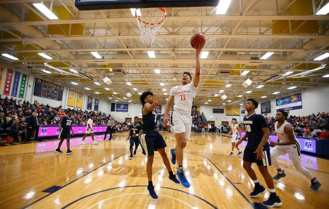 Park guard Noah Hutchins drives to the basket against Canisius during the second half of the Class A Manhattan Cup final at the Koessler Center on Tuesday. (Harry Scull Jr./Buffalo News)