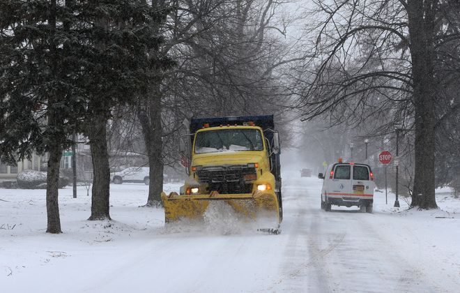 A plow clears snow and salts on Parkside Avenue in Buffalo, on Wednesday, Feb. 27, 2019. (John Hickey/Buffalo News)