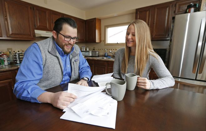 Colton Lemke, 26, and girlfriend Hanna Jeziorski, 24, bought a three-bedroom ranch in Depew in November. They saved money  by living separately with their parents while she finished nursing school.  (Robert Kirkham/Buffalo News)