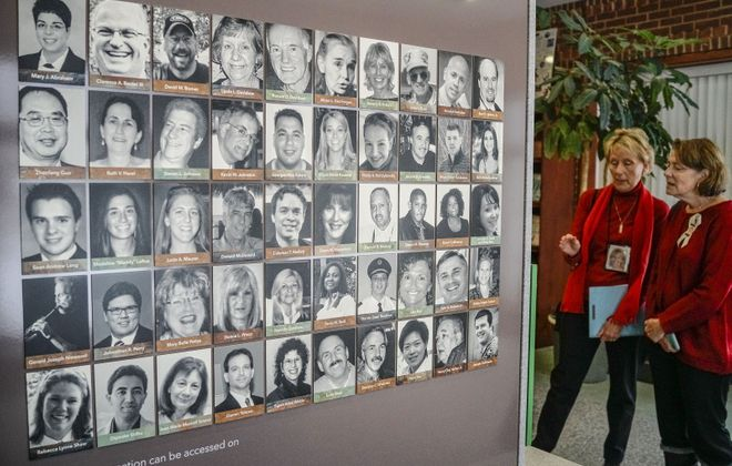 Photographs of all 50 victims adorn one side of the Flight 3407 Memorial at the Clarence Public Library. A database of pilots, mandated nine years ago, is finally moving ahead.  (Derek Gee/News file photo)