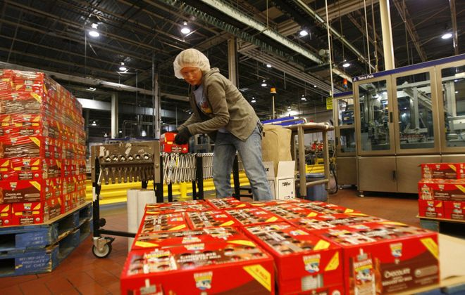 Worker Nicole Kondziela loads cartons of drink boxes onto a pallet at Steuben Foods in Elma. (Derek Gee/News file photo)