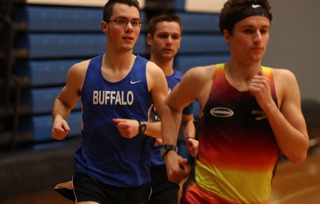 Caleb Covell, left, 20, a mechanical engineering major on the University at Buffalo track team, excels at the 3, 5 and 10K distances. He credits healthy choices and dedication to his training for his success. (Sharon Cantillon/Buffalo News)