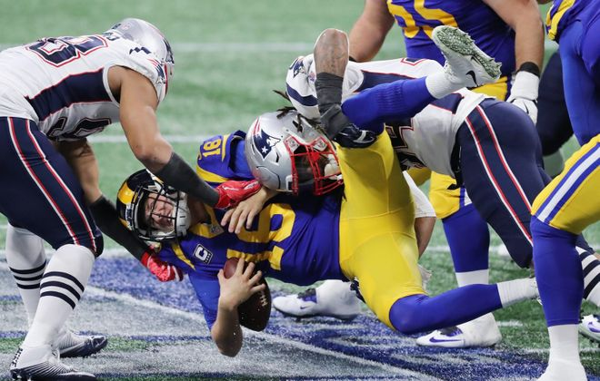 Jared Goff of the Los Angeles Rams is sacked in the first half during Super Bowl LIII against the New England Patriots. (Elsa/Getty Images)