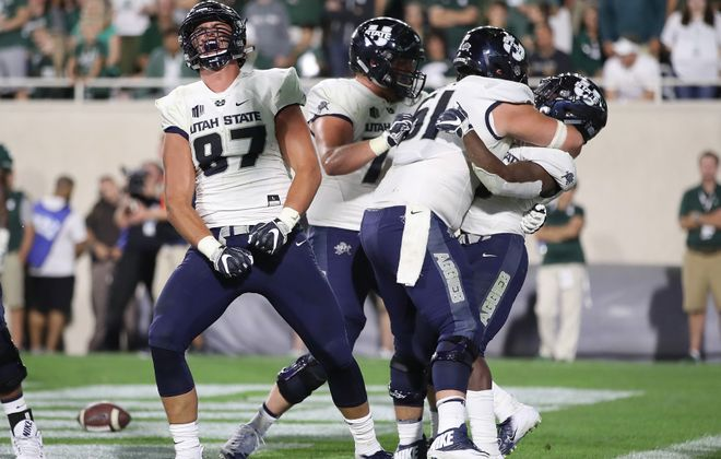 Utah State tight end Dax Raymond celebrates a TD by a teammate against Michigan State this season. (Getty Images)