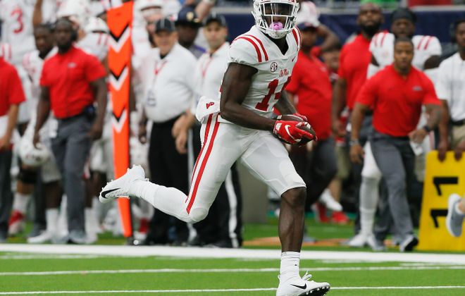 D.K. Metcalf of the Ole Miss Rebels runs for a 58-yard score against Texas Tech in a game in September. (Getty Images)
