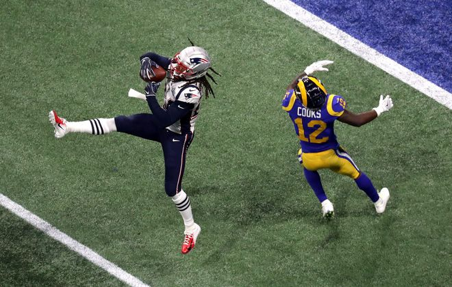Patriots cornerback Stephon Gilmore makes an interception in the fourth quarter of Super Bowl LIII on Sunday. (Getty Images)