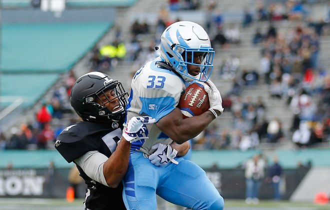 BrandenOliver of Salt Lake Stallions is brought down by MatthewWells of the Birmingham Iron during an Alliance of American Football game at Legion Field on Feb. 16, 2019. (Todd Kirkland/AAF/Getty Images)