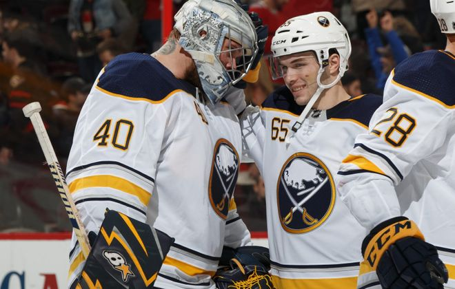 Robin Lehner, left, and Danny O'Regan celebrate a Sabres win in March 8, 2018. (Andre Ringuette/Getty Images)