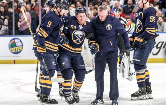 Buffalo Sabres winger Jeff Skinner is helped off the ice during the second period Saturday afternoon in KeyBank Center. (James P. McCoy/Buffalo News)