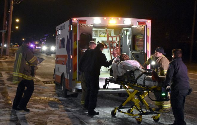 First responders load an 18-year-old shooting victim into an ambulance in front of George's Pizza, 2910 Hyde Park Blvd., Niagara Falls, on Feb. 8, 2019. (Larry Kensinger/Special to The News)