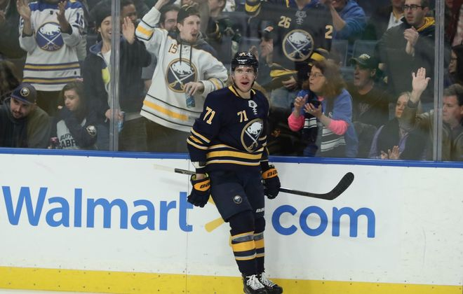 Sabres center Evan Rodrigues reacts to scoring the first goal Tuesday night on the power play. (James P. McCoy/Buffalo News)