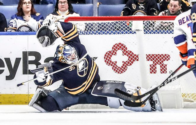 Buffalo Sabres goaltender Linus Ullmark (35) makes a save on a shot from New York Islanders center Mathew Barzal (13) in the third period at KeyBank Center in Buffalo, NY on Tuesday, Feb. 12, 2019. (James McCoy/Buffalo News)