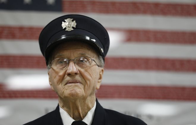 Army veteran Elmer Wienclawski, 99, in his uniform at the Brighton Volunteer Fire Company No. 5, where he remains an active member. (Derek Gee/Buffalo News)