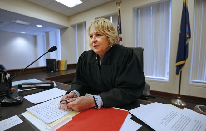 """""""We make a positive difference daily in these families' lives,"""" says Supreme Court Justice Deborah Haendiges, who presides over  Erie County Integrated Domestic Violence Court.(Robert Kirkham/Buffalo News)"""