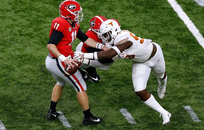 Charles Omenihu (90) of the Texas Longhorns pressures Jake Fromm (11) of the Georgia Bulldogs during the first half of the Allstate Sugar Bowl at the Mercedes-Benz Superdome on Jan. 01, 2019, in New Orleans. (Jonathan Bachman/Getty Images)