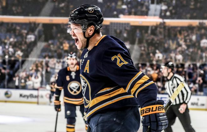 Kyle Okposo is fired up after Johan Larsson's clinching goal with 2:25 left in the game (James P. McCoy/Buffalo News).