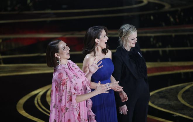 From left: Maya Rudolph, Tina Fey and Amy Poehler strike a pose Sunday during the 91st annual Academy Awards. (Noel West/The New York Times)