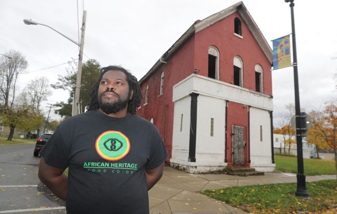 """""""They kept moving the goal posts,"""" said Alexander Wright of the owners who purchased this burned-out building at 238 Carlton. """"I just feel like they're playing games."""" Wright wanted to purchase the building for his African Heritage Food Cooperative. (John Hickey/Buffalo News file photo)"""