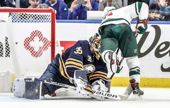 Linus Ullmark takes a blow to the head as he stops Zach Parise final shootout attempt to seal the Sabres' win Tuesday over Minnesota. (James P. McCoy/Buffalo News)