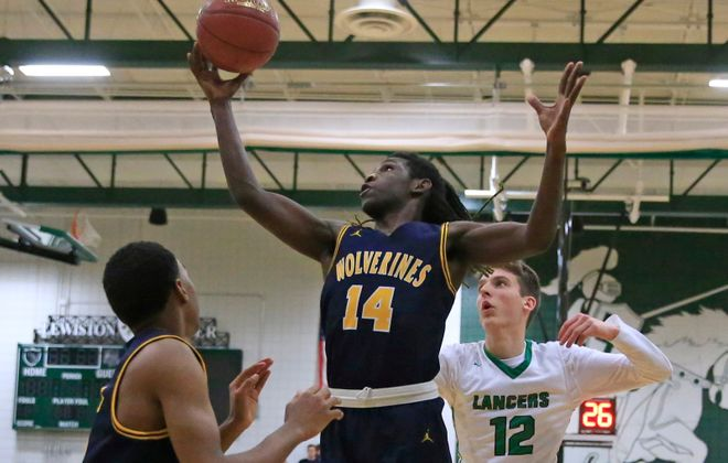 Niagara Falls' Moran Montgomery (14), shown here against Lewiston-Porter, shined for the Wolverines during their 83-63 rout of Aquinas on Saturday night. (Harry Scull Jr./Buffalo News file photo)