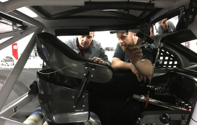 Mark Kelso (left) is at work at the JTG Daughherty race shop in North Carolina. (Photo courtesy of JTG Daughtery Racing)