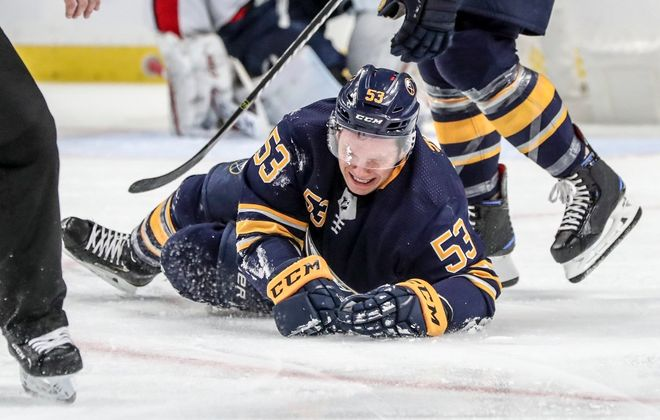 Jeff Skinner grimaces in pain after injuring his left leg in the second period. (James P. McCoy/Buffalo News)