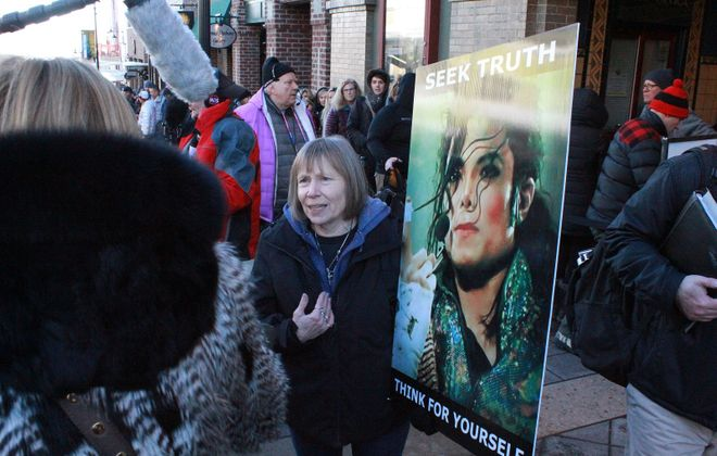"Brenda Jenkyns speaks to reporters last month at the Sundance Fil Festival while protesting ""Leaving Neverland,"" a new documentary mini-series detailing accusations of sexual abuse against the pop star Michael Jackson. (Jason Bailey/The New York Times)"