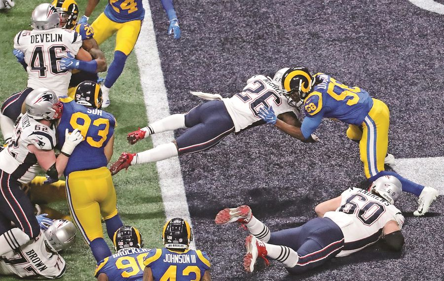 New England Patriots running back Sony Michel (26) rushes for a fourth-quarter touchdown Sunday to take the lead against the Los Angeles Rams during Super Bowl LIII at Mercedes-Benz Stadium in Atlanta. (John Spink/Atlanta Journal-Constitution/TNS)