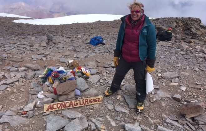 Erin Parisi, the Clarence native seeking to become the first transgender mountaineer to climb the tallest mountains on every continent, celebrates on top of Mount Aconcagua in Argentina Feb. 9, 2019. (Courtesy TranSending7)