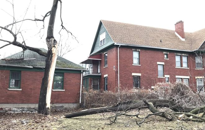 A fallen tree near this house on East Delavan Avenue is one of many across Western New York. Sunday's wind storm prompted at least two area school districts to close Monday. (Robert Kirkham/Buffalo News)