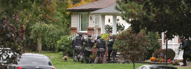 The Town of Tonawanda SWAT team searched a home on Mayfield Avenue in 2013 as part of a case that ended with a man's death. (News file photo)