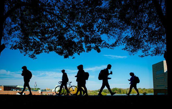Students walk along University at Buffalo's North campus.