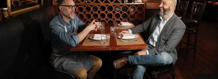 Carmelo Raimondi, left, and Alessandro Renzi have made a television show, about porchetta, and polenta, and creampuffs – but also about family ties, growing and cooking food, and all the ways those things nourish people. (Sharon Cantillon/Buffalo News)