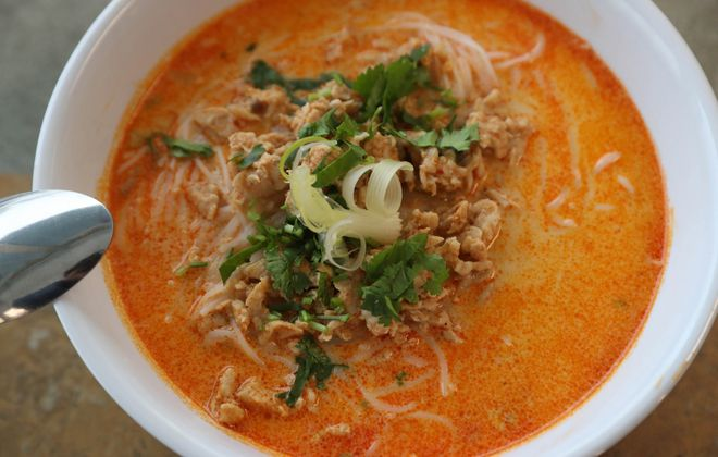 Gourmet Lao Foods' khao puen is a rice vermicelli soup made with coconut milk, chicken, garlic, onion, bean sprouts, lettuce, cilantro and lime. (Sharon Cantillon/Buffalo News)