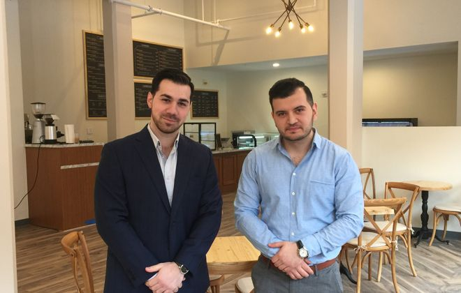 Greg Grigorian, left, and Armen Pogosyan are opening Mon Ami Cafe in Cathedral Place. (Andrew Galarneau/Buffalo News)