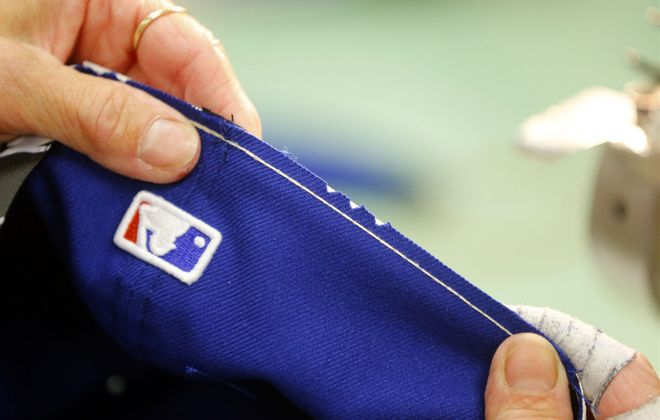 The New Era Cap Co., which has made baseball caps at its Derby plant for roughly a half-century, is shutting down that Western New York operation. (Mark Mulville/Buffalo News)