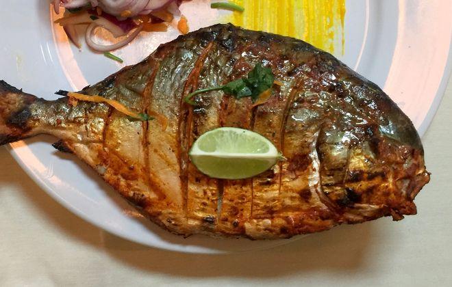 At Nellai Banana Leaf, a whole pompano rubbed with Chennai spice paste and finished on the griddle. (Andrew Galarneau/Buffalo News)