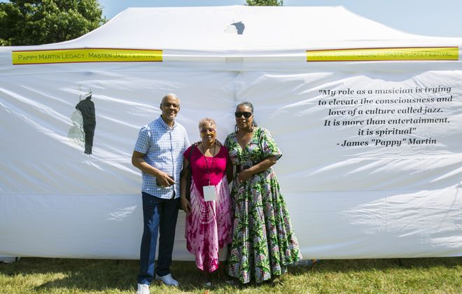 "Celebrating their father  James ""Pappy"" Martin, are James Martin Jr., Denise Watson and Dawn-Berry Walker, who are standing  in front of a quote from their father at a recent Pappy Martin Legacy - Masten Jazz Festival. (Buffalo News file photo)"