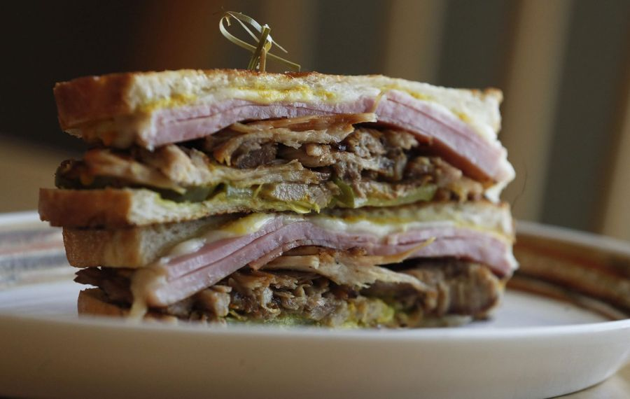 Villa Coffee House's Cuban sandwich is made with slow-roasted pork shoulder, ham, Swiss cheese, pickles, mustard, on grilled DiCamillo bread. (Sharon Cantillon/Buffalo News)