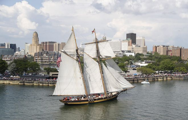 """Tall ships come to Canalside during the Parade of Sail for """"Basil Port of Call: Buffalo"""" on Thursday, July 4, 2019. The Pride of Baltimore II heads down the Buffalo River to Canalside. (Sharon Cantillon/Buffalo News)"""